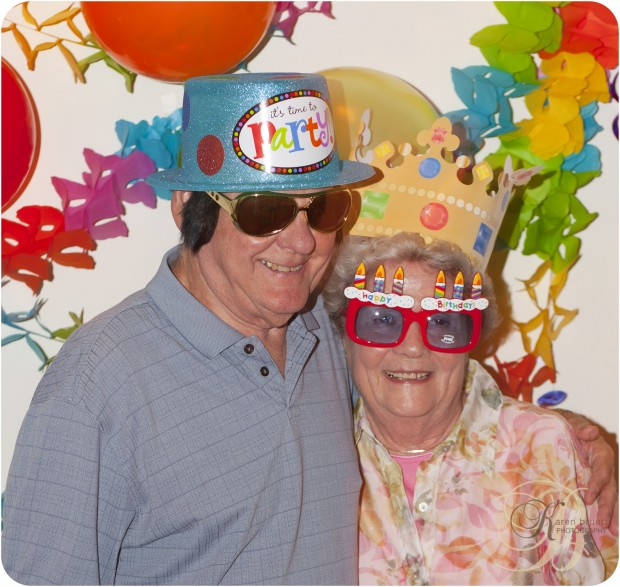 Even the grandparents don party hats and glasses for the birthday pictures