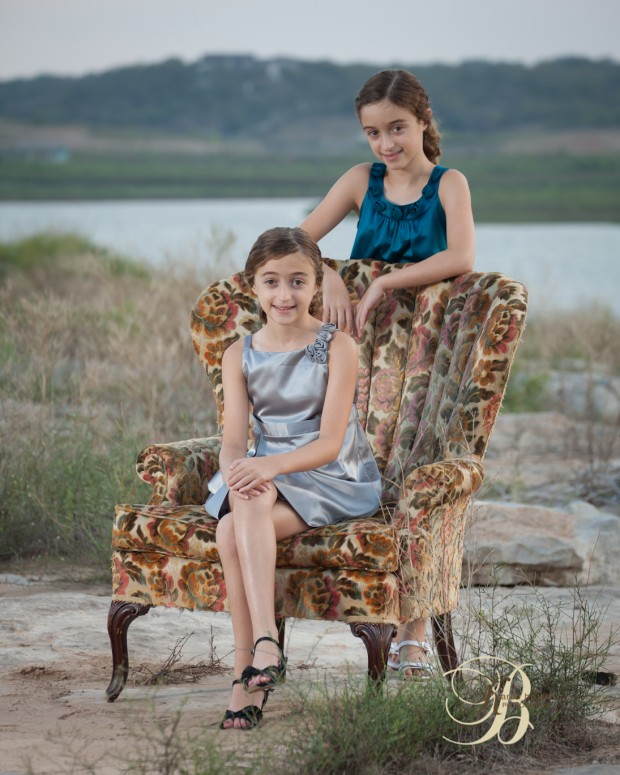 Outdoor portrait with sisters on vintage chair